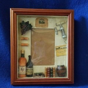 Shadow box frame with a wine theme